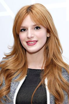 Bella Thorne's thick bangs are shorter in the middle and tapered to the sides blended into layers. Harper's Bazaar, February 2012.
