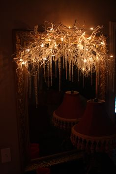 branches with white lights and icicles..over a mirror or mantle...