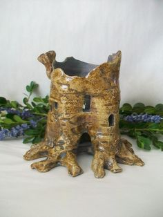 $42 Tree Stump Fairy House and/or Night Light, Handmade on the Potters Wheel.  When I finally get a garden, I'm going to make my own fairy village, I think its such a cute concept and maybe I will have frogs living there and they will eat all the bugs!