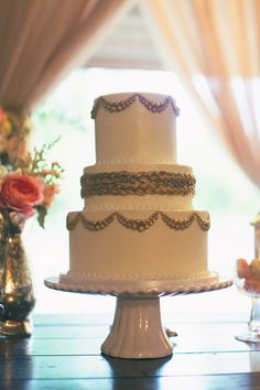 gold braid wedding cake, photo by Alixann Loosle http://ruffledblog.com/blush-and-gold-utah-wedding #cakes #weddingcake #gold