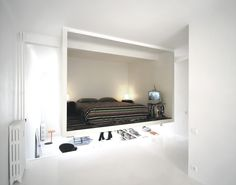 How cool is this? A bedroom in an apartment saving space by hanging from ceiling.