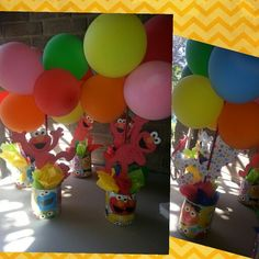 Elmo Balloon Centerpieces Made with Formula cans, wrapping paper, wooden dowels, tissue, cardstock and balloons.