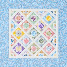Plant a garden of floral Square-in-a-Square blocks using sweet 1930s reproduction prints. Let white sashing represent the picket fence.