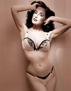 Dita in a nude satin wonderbra and thong
