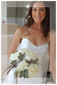 White peonies, succulents and foxtails in bridal bouquet
