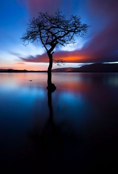 Distant city lights illuminating clouds during a fifteen minute exposure. Loch Lomond. Scotland
