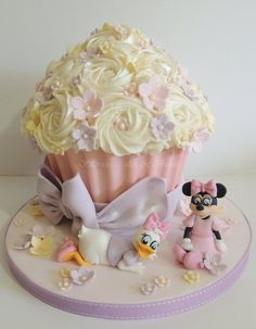 Daisy Duck and Minnie Mouse themed giant cupcake - Daisy Duck and Minnie Mouse themed giant cupcake - You dream it ... I make it!