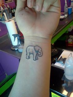 I will have an elephant tattoo. They symbolize good luck (trunk up); obstacles overcome; remembrance; slow ascent to success; strength; power and wisdom. In Thailand, Elephants are good luck. LOVE. Wrist Tattoo, Symbols Of Strength Tattoos, Small Tattoo, Elephant Tattoo Wrist, Tattoo Design, Elephant Tattoos, Amazing Tattoo, 10 Wrist, Simple Tattoo Elephant