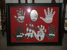 Hand prints of grandchildren and a group picture framed for their grandparents!