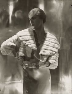 Model is wearing a short ermine summer jacket with gloves and bracelets 1931