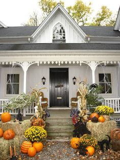 Create a classic country vignette on your front porch for Halloween by arranging hay bales, mums, pumpkins, and dried corn stalks around your steps. Fake spiderwebs add a not-too-scary touch.
