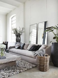 home. cozy. well-lit. simple. perfect. --- oh and I just love the rug and coffee table!!!