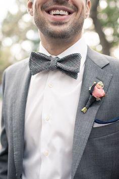 grey bow tie and pink boutonniere, photo by MGB Photo http://ruffledblog.com/manhattan-loft-wedding #groom #bowties