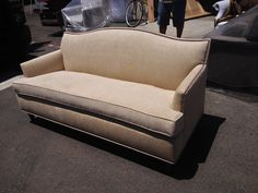 Sofa w/ nailhead detail reupholstered by Garcia Furniture Designs.