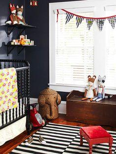 Kid-Friendly Style: Black walls in a nursery is so dramatic!