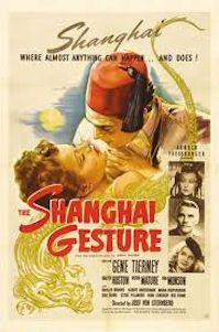 Victor Mature looking creepy in a fez in Shanghai