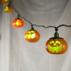 Twinkling, multicolored Jack o' Lantern string lights alternate between a green and red glow...they'll lead the Trick-or-Treaters straight to your door! #Halloweendecor #Pumpkinlights light altern, halloween light, string lights, lantern string, jack o lanterns, door