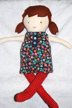 ... this Black Apple Rag Doll out of my daughter's baby clothes. Thanks to pattern & instructions on Martha Steward.