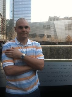 Phil Brooks at the World Trade Center memorial wearing a two-tone Rolex Submariner.