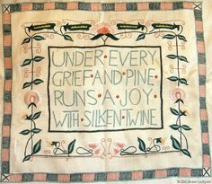 "Jessie Newberry (1864-1948) - Silkwork Embroidered Cushion Cover. Embroidered with ""Under Every Grief and Pine Runs A Joy With Silken Twine"" - after William Blake. Circa 1900. 16"" x 12""."