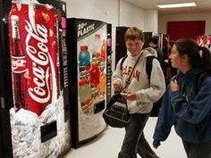 Even though Coca-Cola is no longer selling Coke in schools, the company still markets to kids in schools on vending machines, scoreboards, and other places.