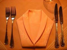 Napkin folded to make a shirt