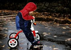 On her tricycle playing in the rain. There's just something about playing in the rain ...