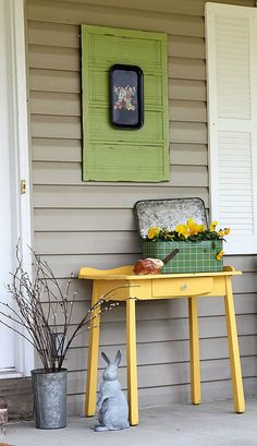 Colorful spring front porch decorated with vintage and thrift store finds