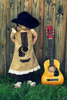 Cute little guitar dress on a cute little girl