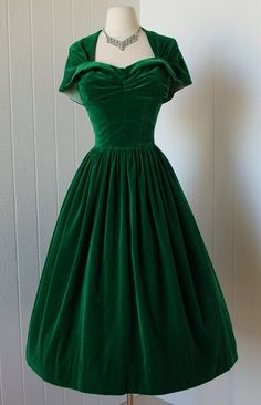 1950's by Kay Selig, green velvet party dress with wing bust and detachable capelet.