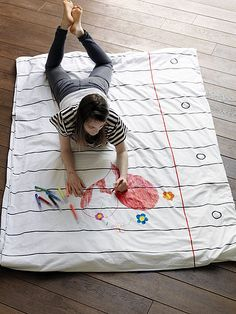 This duvet cover comes with its own pack of 8 wash-out doodle color pens.