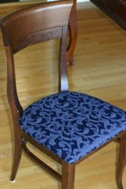 Reupholster a dining room chair.  I need to learn how to do this to cover up the orange fabric there now.