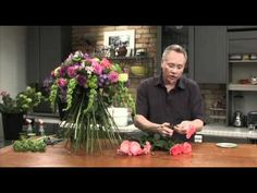 J shows an EASY Trick for concealing a water supply and making a hand tied bouquet that can be set on a table for many hours. This trick using a Sphere of Foam will allow you to design your flowers so they LOOK Like a Hand Tied Bouquet... with none of the worry about them being out of water!