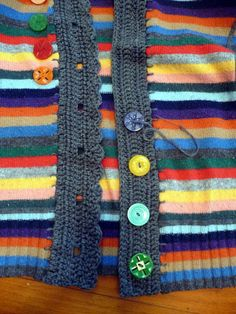 Turn an old pullover into a cardigan with added crocheted bands. Great tutorial by Linda Permann.