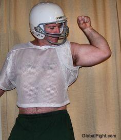 football hunk flexing bicep