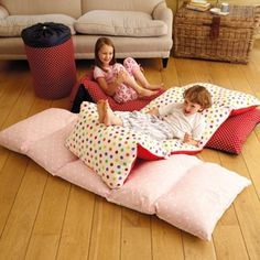 Previous pinner said: Used a twin sheet ( that I found for $2.24 clearance) folded long ways. Sewed 5 sections to the size of pillowcases and slipped the pillows in. I left each 'pillow compartment' end open so the pillows can be removed and we can wash the cover. Kids love it on the family room floor! I am SO making these!.