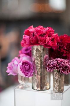 bright flowers in these gorgeous jars.