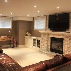 stone fireplace with built ins along the side. love the trim around the windows