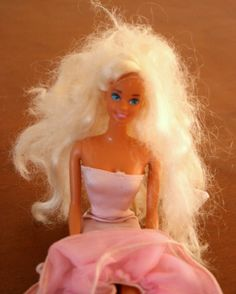 """Barbie Hair Fix"" at DIY Home Sweet Home.  Instructions on how to turn this ""rat's nest"" into a silky, smooth hairdo using fabric softner - so easy!"