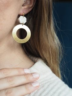 Knitted texture clay earrings with a brass circle pendant. They are super light and comfy to wear! Visit my Esty shop to see more of the unique clay earrings I make.