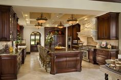 This kitchen was custom designed for maximum ease of cooking and entertaining. Cabinetry and tile designs and specifications were developed through Wanda Bogart Interior Design Studio.