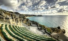 The Minack Theatre at Porthcurno Cornwall was planned,built, and financed by Rowena Cade. The first performance at the theatre was The Tempest in 1932