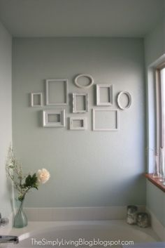 spray paint mismatched picture frames from thrift stores/tag sales and hang on wall