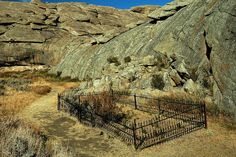 Cemetery WY Independence Rock - Graves are scattered along the Oregon Trail route. There are three graves at Independence Rock. They are protected by an iron fence. irons, independence rock, fences, trail grave, oregon trail, place, passport, independ rock, rocks