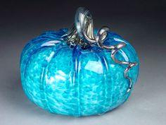 Beautiful hand blown glass pumpkin in jewel tone pumpkin art, glass art, hand blown glass, glass pumpkin, aquamarin, jewel tones, color blue, aqua marine, electric blue