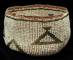 Very rare beaded Modoc basket. The Modoc were Native American Indians who once lived in California and Oregon who were forced onto reservations in Oregon and Oklahoma.