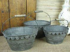 galvanised buckets: three