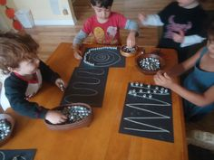 Following designs with small beads or pebbles, great manipulative exercises.