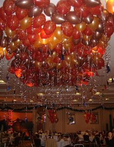 I loved the balloon ceiling in the Sex and the City Movie, when Carrie and Miranda go out for Valentine's Day. I think reds, oranges, yellows, and golds.