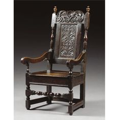A SMALL ARMCHAIR, WILLIAM AND MARY oak, with carved back and boarded seat